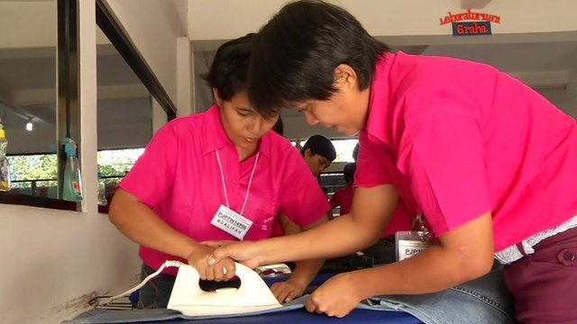 Student being taught to iron