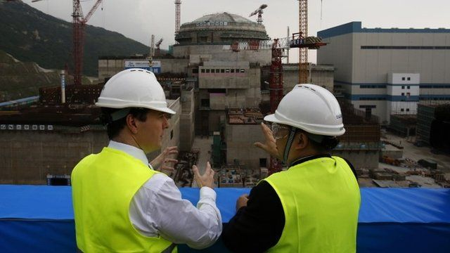 George Osborne (L) talks with Taishan Nuclear Power Joint Venture general manager Guo Liming