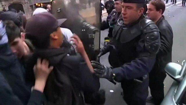 Student protesters with French police