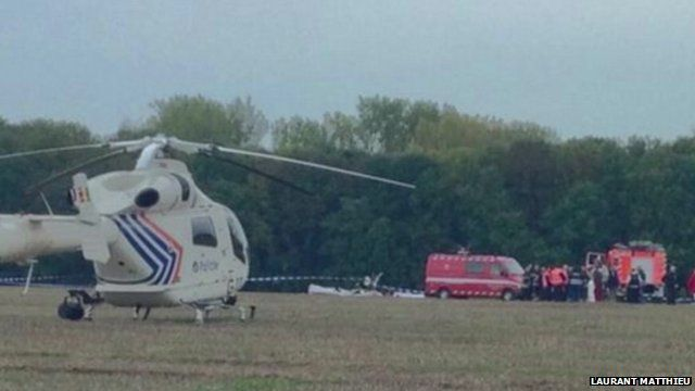Helicopter and emergency vehicles at the scene of the crash
