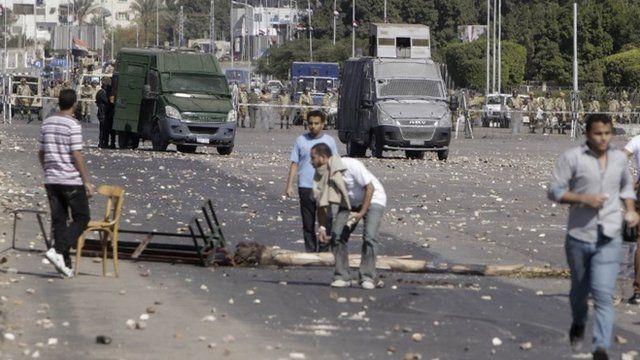 Protesters block a road