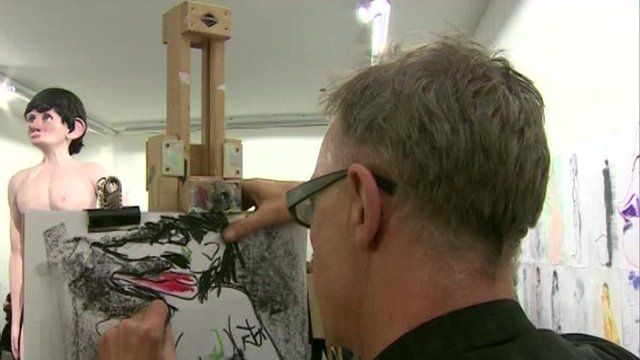 Person drawing an exhibit from the 2013 Turner Prize exhibition