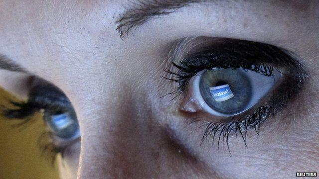 Facebook logo reflected in user's eye