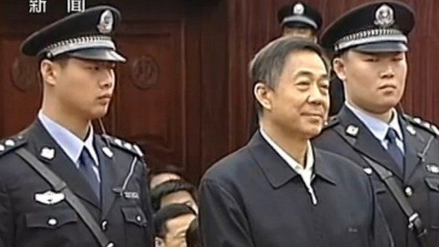 Bo Xilai stands between two guards in court