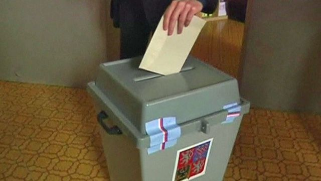 Ballot papers being put into box