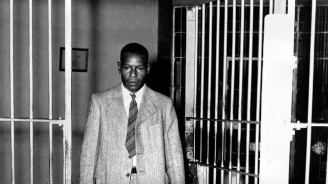 Clarence Norris walks through the main cell gate at Kilby Prison in Montgomery, Ala., after receiving his parole after serving nine years of a life sentence, 1946