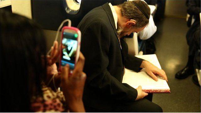 Orthodox Jew studies the Talmud on a commuter train