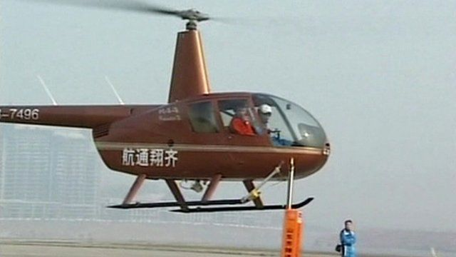 Helicopter pilot positioned to remove top off a beer bottle