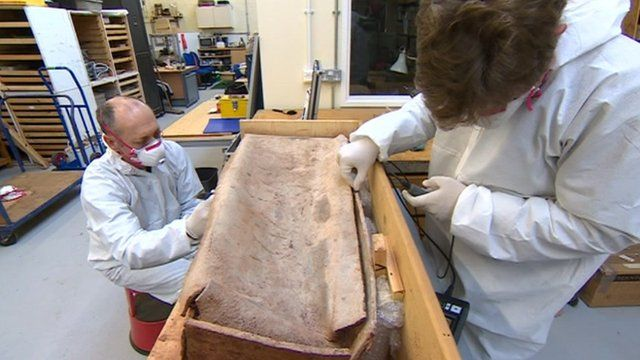 Coffin being examined