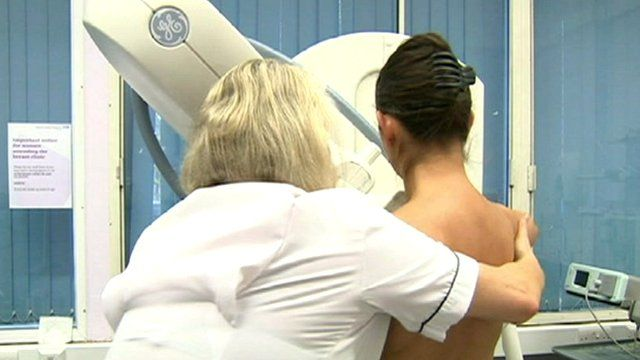 A woman being screened for breast cancer