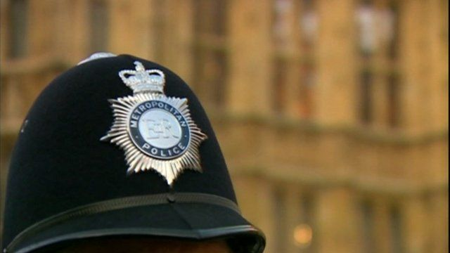 Policeman's hat near Houses of Parliament