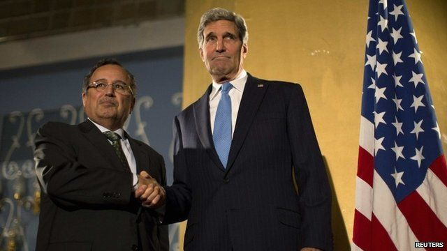 "US Secretary of State John Kerry shakes hands with Egypt""s Foreign Minister Nabil Fahmy"
