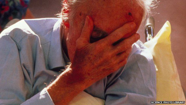 Dementia sufferer covering his face