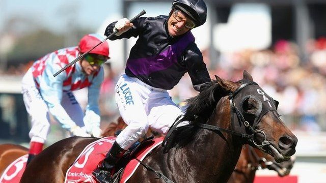 Jockey Damien Oliver wins the Melbourne Cup on Fiorente