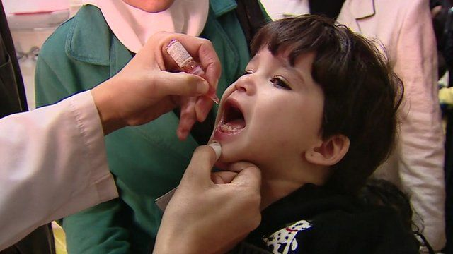 Syrian child receiving Polio vaccination
