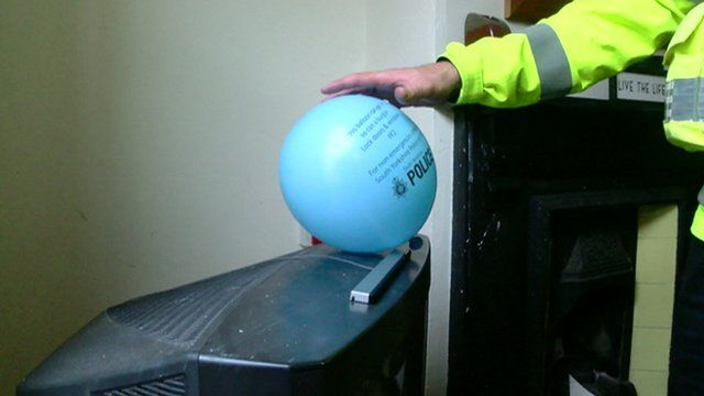 Police leaving a balloon in a home