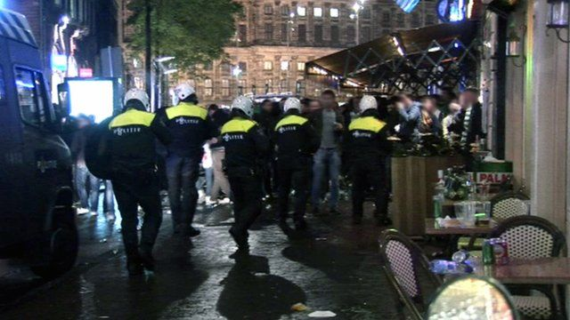 Dutch police and football fans in Amsterdam