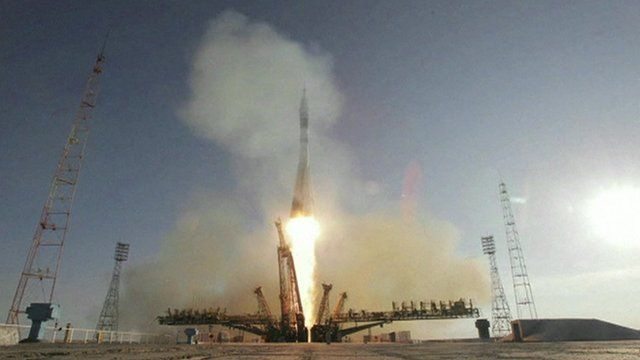 Soyuz rocket launches Olympic torch into space