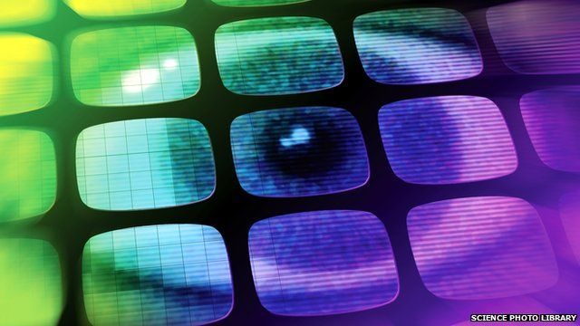 Graphic of an eye imposed on TV screens