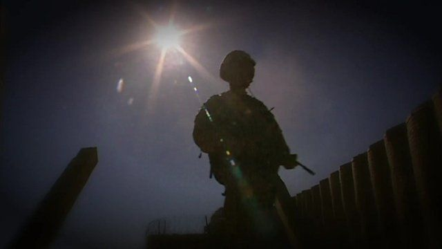 Silhouette of anonymous soldier with gun