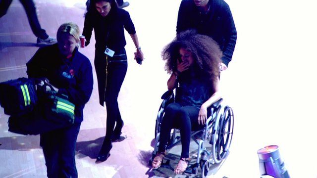 Natalie Gumede is wheeled off the dance floor