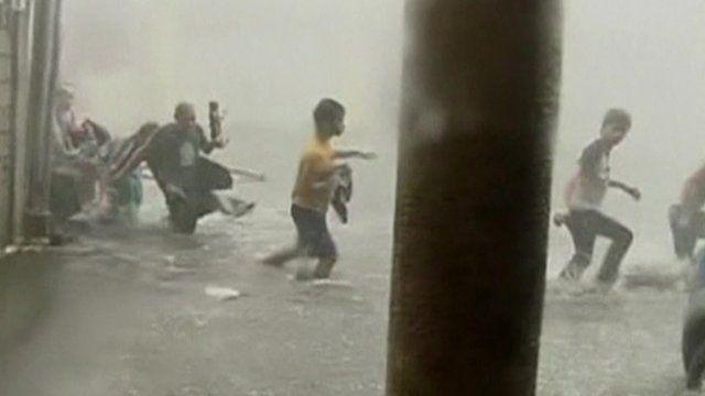People wading through flooding