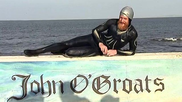 Sean Conway lies on wall painted with the name John O'Groats