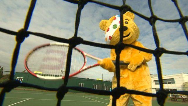 Pudsey Bear playing tennis