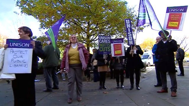People protesting outside Nottinghamshire County Council against job losses and budget cuts