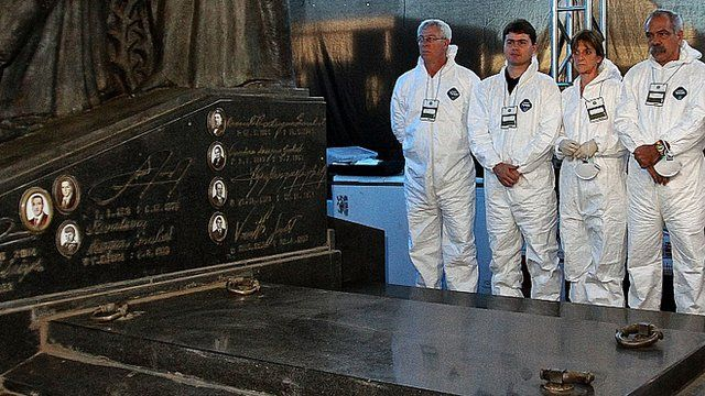A team of forensic scientists stand by the tomb of Brazilian former president Joao Goulart