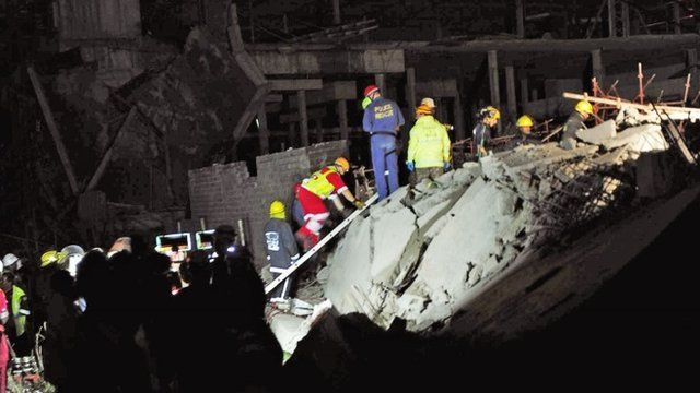 Rescue teams search for survivors at scene of mall collapse