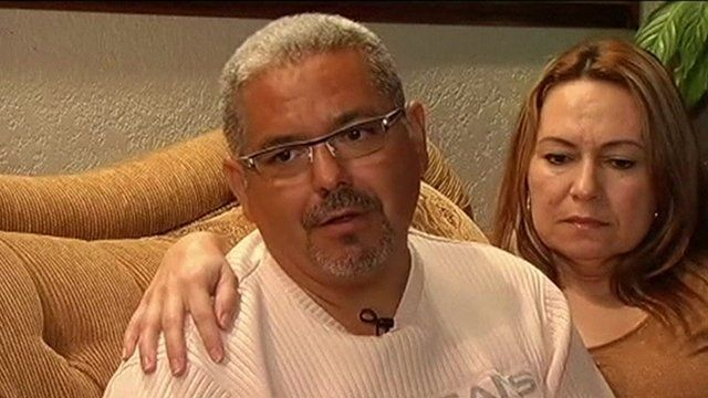 Jose Barrera being comforted on a sofa as he talks about his son