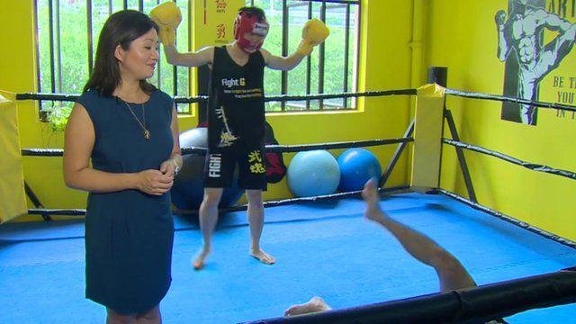 Linda Yueh in boxing ring