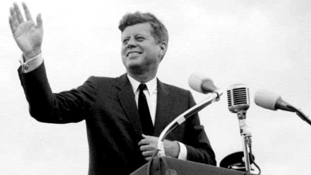 File photo dated 27/06/1963 of US President John F. Kennedy acknowledging the cheers of the crowd when he visits New Ross, Co. Wexford, Ireland