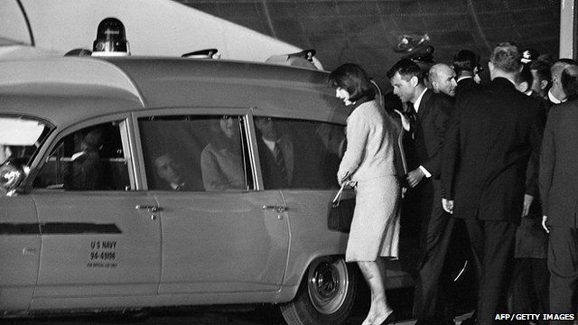 First Lady Jacqueline Kennedy and Robert Kennedy get into the Navy ambulance which carries President Kennedy's body