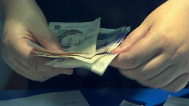 Person handling cash