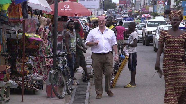 Matthew Davies in Accra market