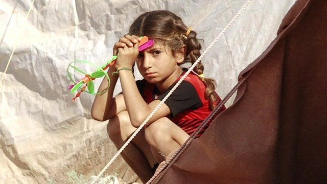 A girl in a refugee camp in Syria