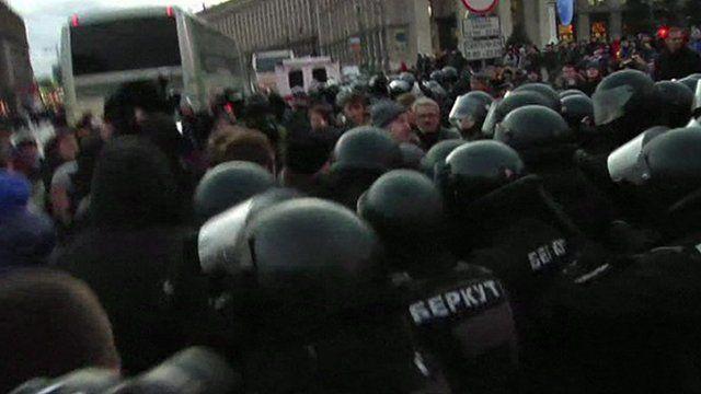 Police and protesters in Kiev