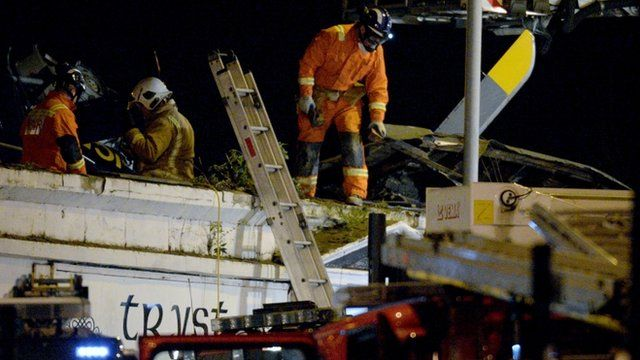 Emergency crew on the roof of the Clutha Vaults pub