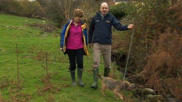 Rob and Marcel Smith walk their dog