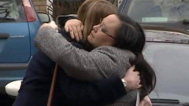 Trevyn Hope Joslin's mother (right) hugs teacher