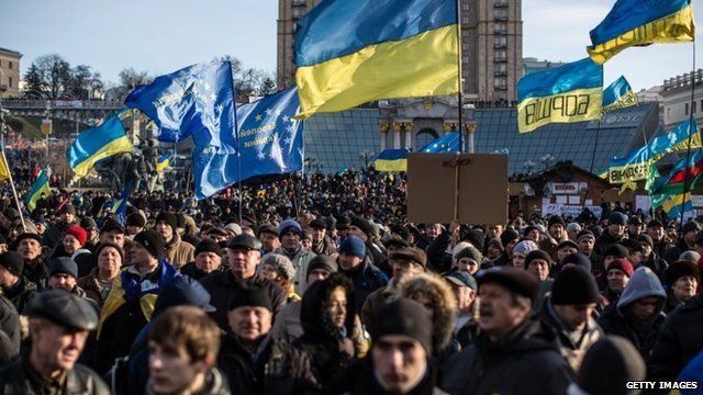 Protesters with flags in Independence Square