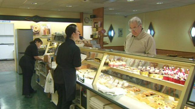 Staff and customers in a bakery