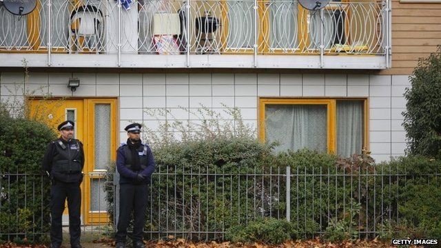 Police outside the block of flats investigated in connection with the alleged slavery case
