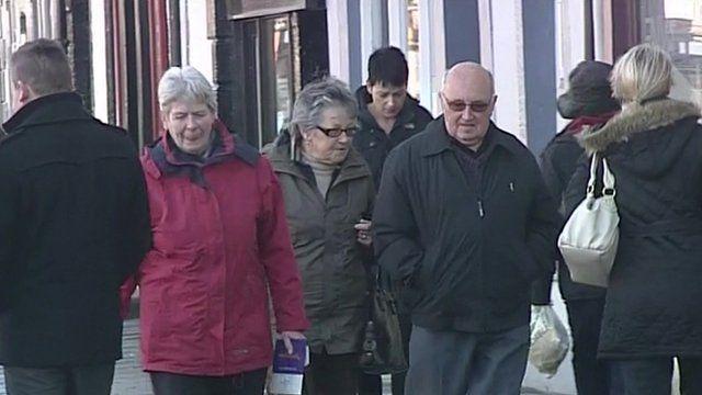 People walking down shopping street