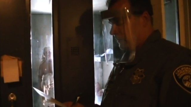 Guard stands outside cell of mentally ill inmate