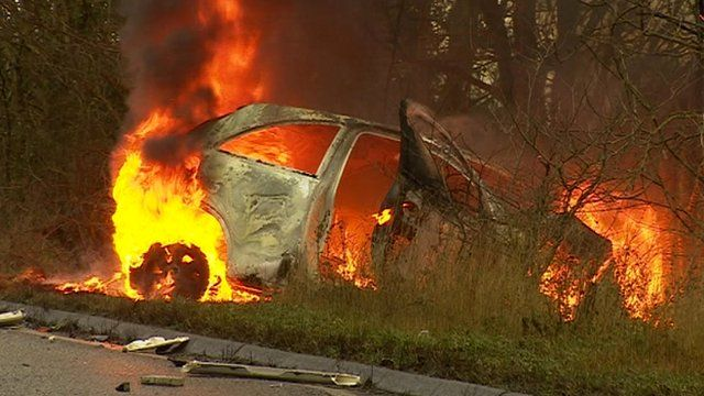 Crashed car on fire on the A140, Suffolk