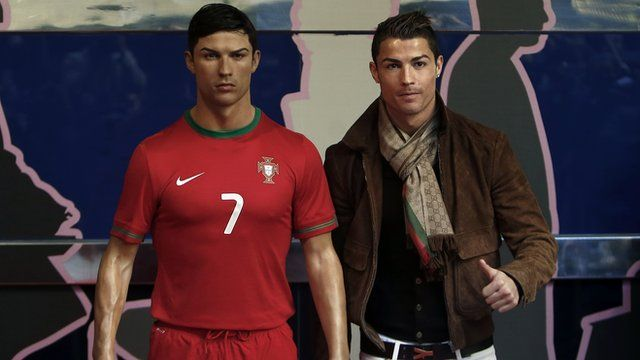 Cristiano Ronaldo stands next to wax figure of himself
