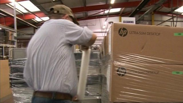 Worker at computer recycling factory in Porth